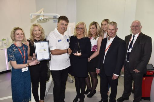 Milne, Spencer & Harris Dental Practice receiving their award at the 2017 BDIA